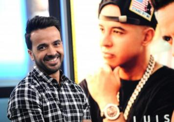 "The speed with which ""Despacito,"" by Luis Fonsi and Daddy Yankee (pictured behind him), became the most-streamed song points to the increasing popularity of music streaming services."