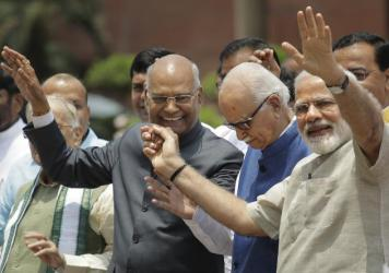 India's new President Ram Nath Kovind, accompanied by wife Kavita Kovind, receives greetings from well-wishers after being elected in New Delhi on Thursday. Kovind was elected to the largely ceremonial post by the Indian Parliament and state legislatures