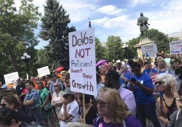 Hundreds of protesters greet Education Secretary Betsy DeVos this week in Denver, where she addressed the American Legislative Exchange Council.