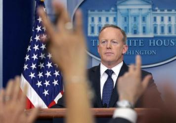 White House press secretary Sean Spicer briefs the media in June. He announced Friday that he was stepping down from his job in the Trump administration and would continue his service through August.