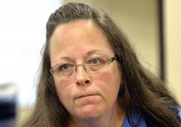 A federal judge on Friday ordered Kentucky taxpayers to pay more than $220,000 in attorney fees for same-sex couples and others who sued Rowan County Clerk Kim Davis for refusing to issue marriage licenses.