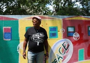 """Teresa Moore's favorite portion of the mural, which was once Detroit's 'segregation wall,"""" or the Birwood Wall. The section pictures Sojourner Truth leading children through the underground railroad."""