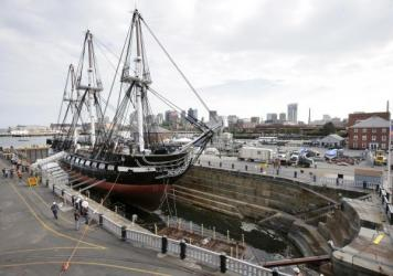 """The USS Constitution, also known as """"Old Ironsides,"""" rests in dry dock as water enters the basin to refloat the vessel Sunday, July 23, 2017, at Charlestown Navy Yard in Boston. America's oldest commissioned warship afloat has undergone over two years of"""
