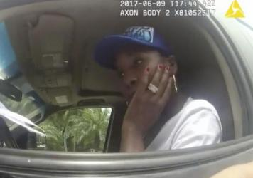 A still from a police body camera video shows tennis star Venus Williams listening to Palm Beach Gardens Police Officer David Dowling following a June 9 car crash in Florida that fatally injured an elderly man.