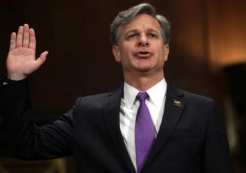 Then-nominee Christopher Wray is sworn in during his confirmation hearing before the Senate Judiciary Committee last month.