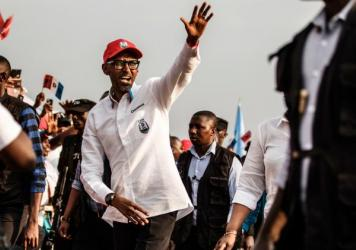 Rwandan President Paul Kagame greets the crowd after addressing supporters at the closing rally of the presidential campaign in the capital, Kigali, this week. Kagame has been in power 23 years and is expected to win a third term.