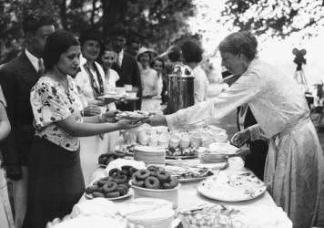 """Eleanor Roosevelt presides over the table at a dinner celebrating her husband's victory in the 1932 Democratic presidential primary. Author Laura Shapiro notes that later, as first lady, Roosevelt would seem """"apathetic about what was on her plate"""" while in the White House."""