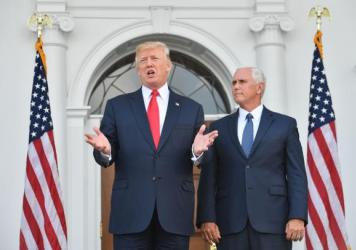 President Trump and Vice President Pence speak to the press on Thursday at the Trump National Golf Club in New Jersey before a security briefing. Trump said he would declare the opioid crisis a national emergency.