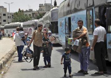 Syrians arriving last month from Jarablus, in Aleppo province, to their old neighborhood of al-Waer, in Homs, Syria. They left their homes to escape the government of Syrian President Bashar Assad, and now they are going back.