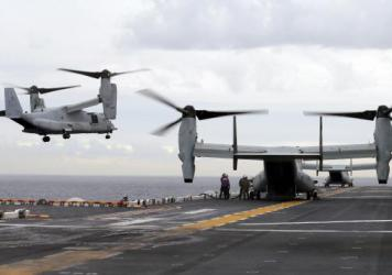 A U.S. Marine Corps MV-22B Osprey aircraft lands on the deck of the USS Bonhomme Richard amphibious assault ship last June off the coast of Sydney, Australia. An MV-22 Osprey that had launched from the USS Bonhomme was conducting regularly scheduled oper