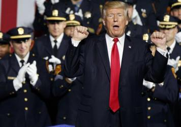 President Donald Trump speaks to law enforcement officials on the street gang MS-13, July 28 in Brentwood, N.Y.