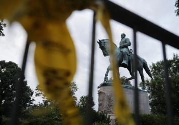 A statue of a Confederate soldier in Atlanta's Piedmont Park stands vandalized with spray paint on Monday. It was not the only Confederate monument to be vandalized in the wake of the violence in Charlottesville; a statue in Louisville, Ky., was splatter