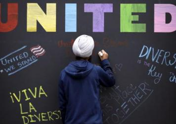 "In December, a Texas A&M student signs a message board ahead of an ""Aggies United"" event in response to a speech by white separatist Richard Spencer. Spencer was scheduled to return to the school for a ""White Lives Matter"" rally on Sept. 11."