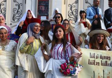 Tunisian women gather to celebrate Women's Day on Aug. 13 in Tunis. On the same day, the country's president announced the review of a law requiring that a man receive twice the share of an inheritance as a woman.