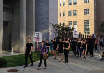 Demonstrators march from the courthouse to the jail in Durham, N.C. Dozens of protesters attempted to turn themselves in to law enforcement Thursday in solidarity with those who have been arrested for toppling a Confederate monument earlier this week.