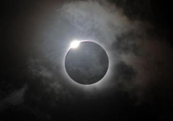 The 'diamond ring' effect is shown following totality of the solar eclipse at Palm Cove in Australia's Tropical North Queensland on November 14, 2012.