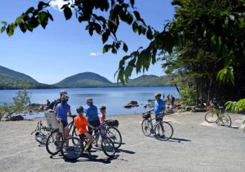 Bike patrol volunteers give directions to visitors at Acadia National Park. The Trump administration has rolled back an Obama-era policy put in place to encourage national parks to end the sale of bottled water.