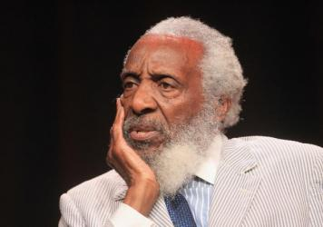 Dick Gregory, known for his sharp commentary on race relations during the 1960s civil rights movement, is considered a pioneer in using satire to address social issues.