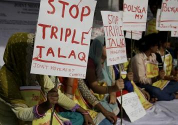 "Activists hold signs during a protest against ""triple talaq,"" the practice of instant divorce by Muslim men, in New Delhi on May 10. The country's Supreme Court has outlawed this means of ending a marriage."