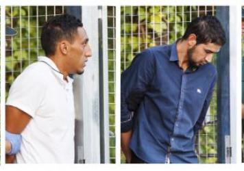 Four men —Mohamed Houli Chemlal (from left), Driss Oukabir, Salah El Karib and Mohamed Aallaa — suspected of being part of a terror cell accused of killing 15 people in attacks in Spain leaves a Civil Guard base on the outskirts of Madrid prior to th