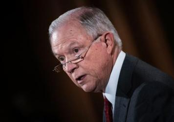 """Attorney General Jeff Sessions speaks at the Department of Justice on Aug. 4. The department is being sued by multiple cities, including now Los Angeles, over its stance on """"sanctuary cities."""""""