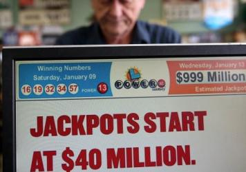 On Jan. 13, 2016, a cashier sells Powerball tickets in San Lorenzo, Calif. Later that day, three winning tickets split the record $1.6 billion jackpot. Wednesday's $758 million jackpot is the largest grand prize won by a single lottery ticket in U.S. his