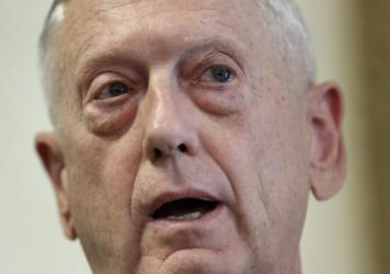 Defense Secretary Jim Mattis, seen here in June, has been relatively quiet about President Trump's call for a ban on transgender service members in the U.S. military. New guidelines would give him leeway to determine who should serve.