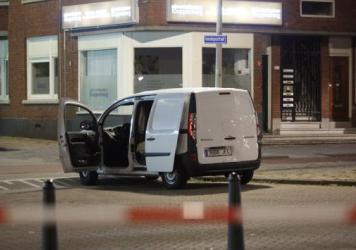 A van registered in Spain sits near the concert venue Maassilo in Rotterdam, Netherlands, where a rock concert set for Wednesday night was canceled because of a terror threat. The driver of the van, which contained some gas bottles, was arrested.
