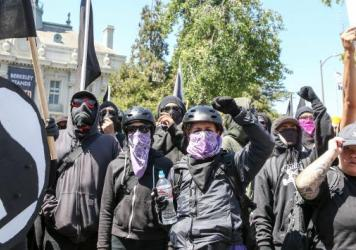 Antifa members and counterprotesters gather during a right-wing No-To-Marxism rally Sunday at Martin Luther King Jr. Park in Berkeley, Calif.
