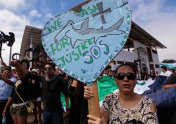 Residents of the Galápagos Islands demonstrate outside the court where the crew of the Chinese-flagged ship had a hearing last week. The Ecuadorean navy earlier this month seized the ship, which had been carrying some 300 tons of fish, including several