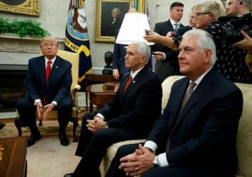 """President Donald Trump, joined by Vice President Mike Pence and Secretary of State Rex Tillerson, listens to a question during a meeting with Finnish President Sauli Niinisto in the Oval Office on Monday. Tillerson, when asked Sunday whether Trump's response to violence in Charlottesville, Va., represented American values, said that """"the president speaks for himself."""""""