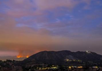 The La Tuna Fire had burned more than 5,000 acres of brush-covered mountains Saturday, as several hundred firefighters worked to contain the blaze.