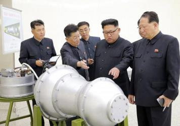 This undated picture released by North Korea's state-run news agency on Sunday shows North Korean leader Kim Jong-Un looking at what Pyongyang claims is a hydrogen bomb, which can be loaded into the country's new intercontinental ballistic missile.