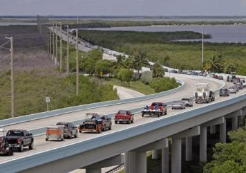 Motorists on U.S. 1 north of Key Largo, Fla., Wednesday, evacuating in anticipation of Hurricane Irma. Are you in Irma's path? Tell us how you're doing.