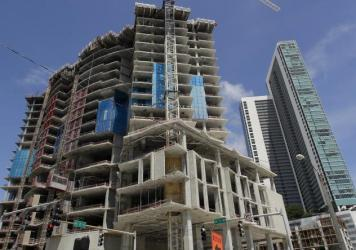 "The deputy director of Miami's building department, Maurice Pons, said in a city statement that he ""would not advise staying in a building next to a construction crane during a major hurricane like Irma."" Here, a high-rise building under construction is seen Thursday in Miami."