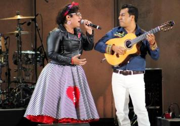 "Vocalist La Marisoul and guitarist Jose ""Pepe"" Carlos from the band La Santa Cecilia perform at the Hollywood Bowl in Los Angeles"