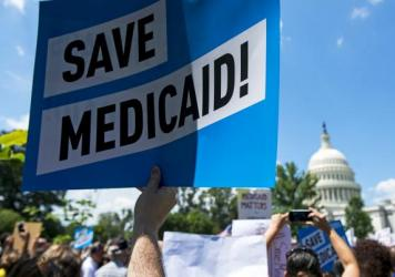 Protesters rally against Medicaid cuts in front of the U.S. Capitol in June. Medicaid is the nation's largest health insurance program, covering 74 million people — more than 1 in 5 Americans.