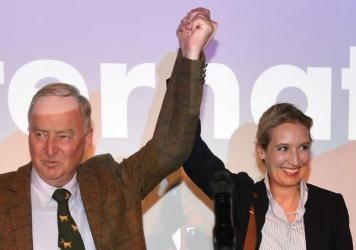 AfD top candidates Alexander Gauland, left, and Alice Weidel celebrate with their supporters during the election party of the nationalist Alternative for Germany, in Berlin, Sunday, after the polling stations for the parliament elections closed.