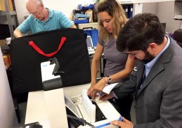From left, Bill Wanlund of the Falls Church electoral board, Jessica Wilson of voting machine company Hart InterCivic and David Bjerke, the Falls Church director of elections test the city's new voting machines ahead of this November's election.