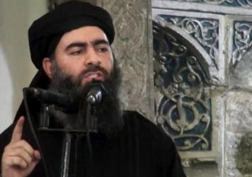 Islamic State leader Abu Bakr al-Baghdadi, purportedly seen here in video posted in 2014, had not been heard publicly for nearly a year — until Thursday, when ISIS released a possible audio recording of Baghdadi.