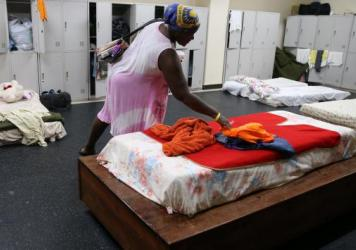 Residents of Barbuda were forced to flee when Hurricane Irma devastated their island on its way through the Caribbean. Here, Jackeline Deazle, whose house lost its roof and windows, is seen at a shelter in the Sir Vivian Richards Stadium last week in Nor