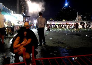People wait in a medical staging area on Monday, after a mass shooting during a music festival Sunday on the Las Vegas Strip. Police say Stephen Paddock fired down at the crowd of more than 22,000 people from his room on the 32nd floor of the Mandalay Ba