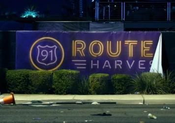 A banner for the Route 91 Harvest country music festival. A shooter killed over 50 and wounded 200 during the festival's final performance in Las Vegas.