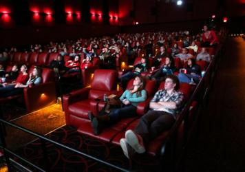 Moviegoers relax in recliner seats at AMC Movie Theater in Braintree, Mass., in 2013.
