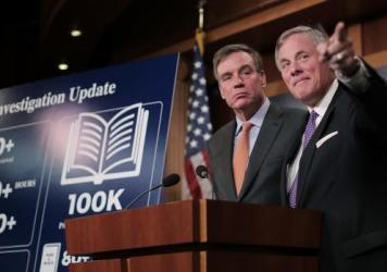 Senate Intelligence Committee Chairman Richard Burr, R-N.C. (right), and committee Vice Chairman Mark Warner, D-Va., hold a news conference on the status of the committee's inquiry into Russian interference in the 2016 presidential election at the U.S. C