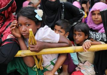Rohingya children wait for food handouts at Thangkhali refugee camp in Cox's Bazar, Bangladesh, on Thursday.