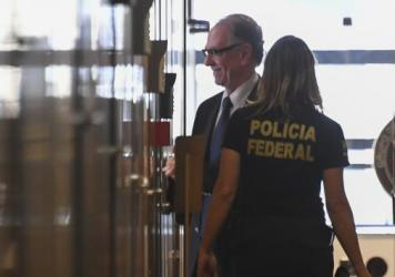 Brazil's Olympic Committee chief, Carlos Nuzman, resigned from his post after being arrested on Oct. 5. He's seen here coming to the Brazilian Federal Police building in Rio de Janeiro for questioning on Sept. 5.
