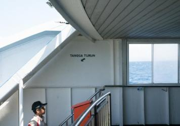 A man stares out at the water as the ferry traverses the nearly 50 miles between stops.