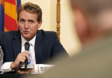 Sen. Jeff Flake, left, R-Ariz., who announced he will not run for reelection on Tuesday, appears at a hearing on border security in Arizona in 2015.