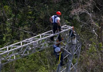 Whitefish Energy workers restore power lines damaged in Barceloneta, Puerto Rico, on October 15. Gov. Ricardo Rosselló has ordered an audit of the $300 million deal the island's power authority made with Whitefish.